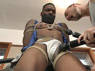 Black hunk endures rough anal plus toying in gay BDSM play