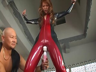 Seductive Japanese whore Emiri Okazaki in latex having MMF sex